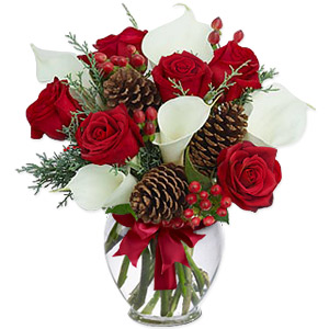 This Divine, Artistically Arranged Assortment Of Pure White Calla Lilies, Elegant Red Roses, Hypericum Berries And Pine Cones Arrives In A Classic Glass Vase. Sprigs Of Conifer And A Nice Red Ribbon Make It A Great Gift To Your Loved Ones This New Year.