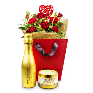 An extravagant, overflowing romantic gift hamper containing gorgeously presented rose plant. Along with this rose plant comes luxurious candle and delicious bottle of crisp and aromatic Bottega Gold! #gift