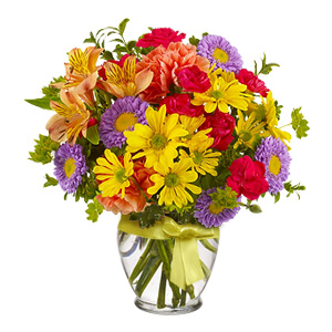 Bright Colors Resembling The Bright Summer Make Up This Cheerful Bouquet Made Of Spray Chrysanthemums, Matsumoto Asters, Miniature Carnations, Carnations And Alstroemeria Accented With Bupleuru. The Arrangement Is Presented In A Clear Vase Adorned With A Yellow Bow.