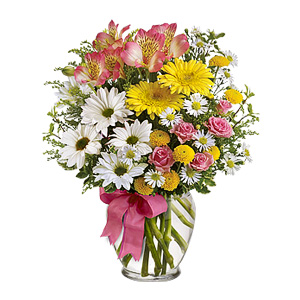 This Sweet Bouquet Of Tiny Daisy Spray Chrysanthemums, Mini Carnations, And Wee Peruvian Lilies Proves That Sometimes, The Loveliest Of Things Comes In The Smallest Of Packages. This Dainty Arrangement Is Highlighted With Bupleurum And Delivered In A Ginger Vase Adorned With A Pink-blush Ribbon.