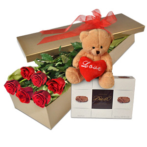 Brilliant red roses, with chocolates and soft toy would make a glorious assortment for Valentines day.