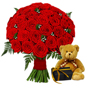 Gift Your Beloved This Sweet And Scrumptious Combination Featuring 50 Red Roses Along With A Teddy And Chocolates And Take Her My Complete Surprise. This Gift Combination Will Surely Floor Her And Make Her Feel Special.