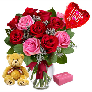 The Ultimate Expression Of Sinful Desire To Surprise Your Loved One, Reflected Through This Bouquet Of A Dozen Red And Pink Roses, Accompanied With A Cuddly Plush Bear, A Box Of Ferrero Rocher Chocolates And A 5 Inch Heart Balloon. Substitution Of Ferrero Rocher Chocolates May Occur In Case Of Unavailability