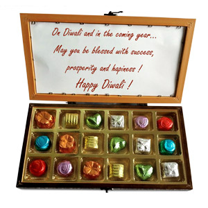 This scrumptious choco-nut gift box consists of 18 almond pistachio chocolates. #gift
