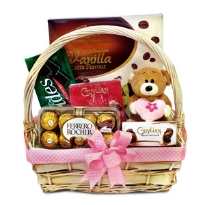 If nothing works, try chocolates. But make sure they're Guylian Classics. Keep the celebrations going with this extravagant Chocolate Gift Basket consisting Tudor Gold Chocolate, Andes Creme de Menthe Thins, Guylian Praline, Guylian Mini Chocolates, Ferre #gift