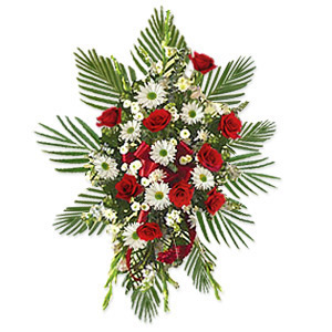 An elegant and beautiful way to send your deepest wishes of sympathy with this exquisite spray made up of roses, lilies, delphinium, iris, lisianthus and evergreen, laced with a fancy red satin ribbon.