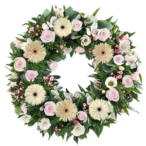 Express your heartfelt thoughts and condolences with this exquisite wreath of fresh and delicate white and pink roses. Approximately 14 to 18 inches in diameter.