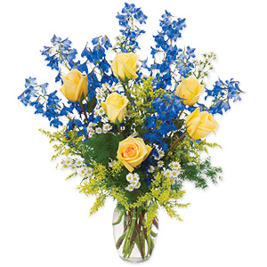 Perfect for any reason, this arrangement of Delphiniums, Monte Casino, Roses, Solidago and Greens in glass vase is a gorgeous gift they're sure to treasure. Create special memories with this beautiful gift. #gift