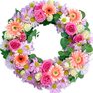 Serene and elegant, express your condolences and grief with this fresh floral arrangement crafted from the freshest seasonal flowers in pastel colors.