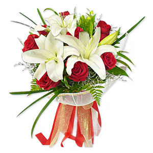 This Lovely Design Combining Style And Beauty In The Form Of Scented Lilies And Vibrant Red Roses, Will Perfectly Compliment Your Loved Ones Home Or Office. Approximately 14 Inches W X 17 Inches H