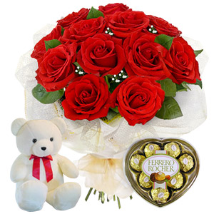 An Extravagant Display Of Passion And Elegance Presented Through This Luxurious Collection Of A Dozen Medium Stemmed Red Roses, Accompanied With An Adorable Cuddly Bear And A Box Of Premium Chocolates.